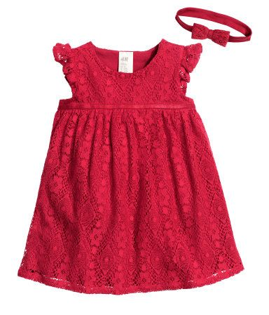 Set with lace dress and hairband. Dress with short ruffle sleeves, concealed snap fastener at one shoulder, flared skirt, and soft jersey lining. Hairband in jersey with attached lace bow.