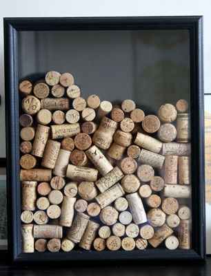 I made one of these with an old shadow box I had that I never used.   Drilled a hole in the top and drop the corks into it as we finish off our next bottle of wine...and our next.....and our next.