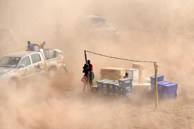 Dust swirls as a UN helicopter takes off in Tali Payam, South Sudan. Photograph by UN Photo/Tim McKulka.