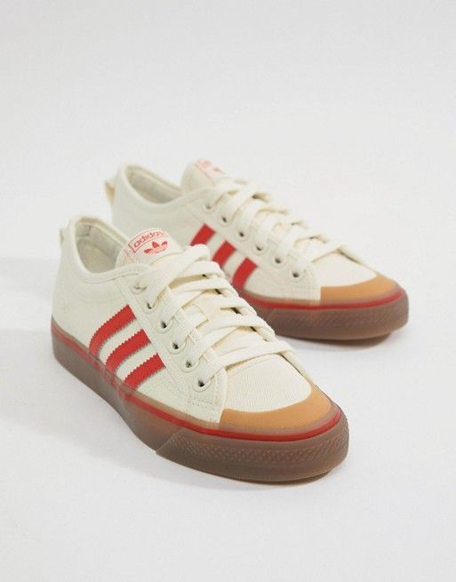 buy popular ed0a4 c0b90 adidas Originals Nizza Canvas Sneakers In White And Red
