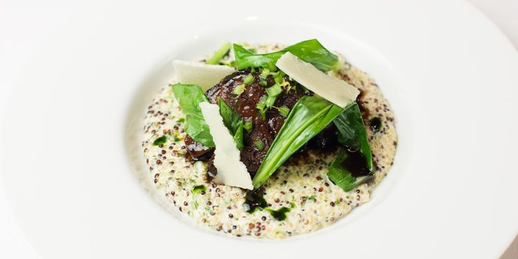 Slow-cooked beef shin with quinoa, wild garlic and Parmesan. Chef Alyn Williams cooks a deliciously tender beef shin recipe which is slow-cooked and served with a luxuriously soft quinoa risotto and a wild garlic oil.