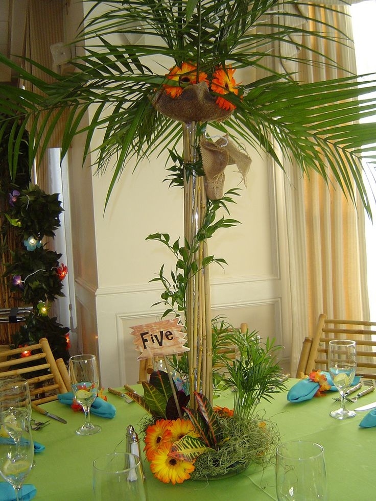 Luau themed centerpiece palm tree table floral for Hawaiin decorations