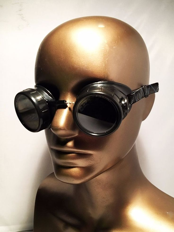 This awesome piece of TV memorabilia is from that Grimm prop warehouse. This is a pair of steampunk goggles with green lenses. They look like camera lenses, and the lenses screw off the base. A chain with a long piece of black plastic holds the two sides together across the bridge, while an adjustable elastic strap holds them on your head. | eBay!