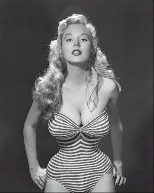 Betty Brosmer and her tiny waist.  Also known as Betty Weider.  Married Joe Weider.  Does resistance / weight training.      Perfect hourglass during her youth at 38-18-36.  Truly live Barbie doll in those days.