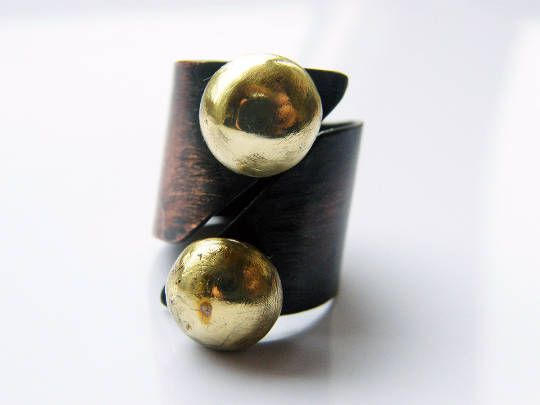 Yin and Yang. oxidized copper ring with two large brass balls