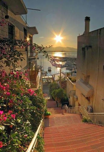 GREECE...SUNSET IN PIRAEUS.