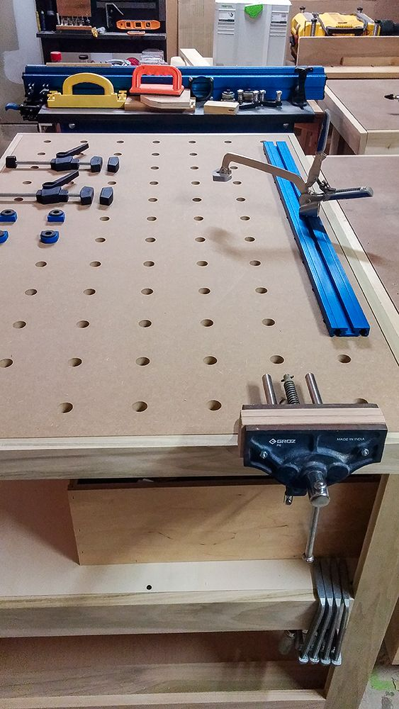 MFT table. A multi-function table for utilizing Festool tools and clamps. I created a system to use Kreg clamps on the MFT top. Plus, the MFT top comes off and can use it on my main bench. Very multi functional.