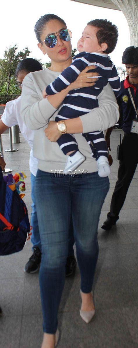 Photos: Mommy Kareena Kapoor Khan pacifies crying Taimur - Entertainment #middaybollywood #bollywoodactors #bollywoodmovies #bollywoodphotos #bollywoodfashion #bollywoodinstant #bollywoodgossip #bollywoodupdates #airportfashion #airportlooks #flyingavtar #bebo #taimur