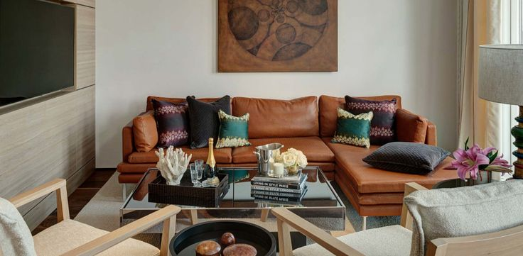 10 Modern Sofas In Incredible Interiors By Hartmann Designs | Living Room Inspiration. Brown Leather Sofa. #modernsofas #livingroomideas #leathersofa Read more: http://modernsofas.eu/2016/10/03/modern-sofas-incredible-interiors-hartmann-designs/