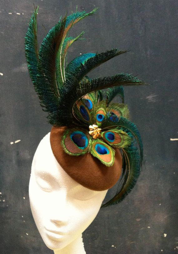 Punky, statement cocktail hat hand made and a one off - definitely for the showgirl in you :) Peacok feathers and gold studs nestle into tan felt. www.fifilabelle.com or visit me on etsy!