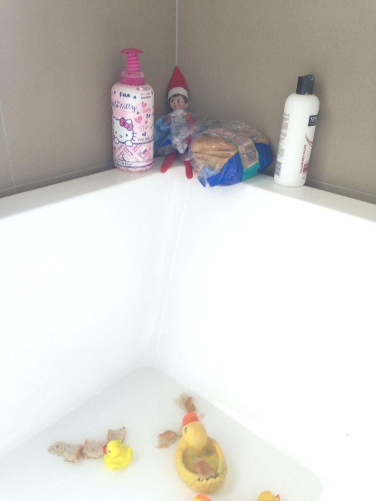 Elf on the shelf feeding ducks in the bath. Pic only