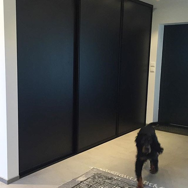 "Beautiful black Kvik sliding doors with black frames  approved by the dog ""Storm"" at the Norwegian home of @esagemo #kvik #stormthedog #smartbykvik #slidingdoors #blackslidingdoors #wardrobe #wardrobesolutions #danishdesign #surpricinglylowprices #135showrooms #11countries"