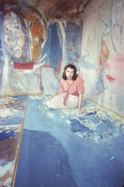 Painter Helen Frankenthaler (at 30) sitting amidst her art in her studio in New York City, 1956