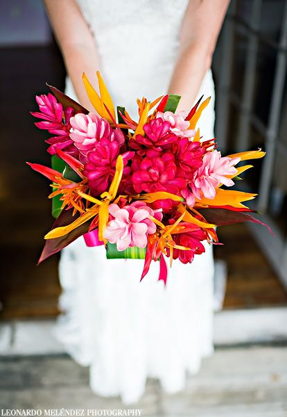 Tropical wedding bouquet made from locally grown plants and flowers - red ginger, pink ginger and birds of paradise! Wedding inspiration by @belizetravel.  Belize wedding photography by Leonardo Melendez.