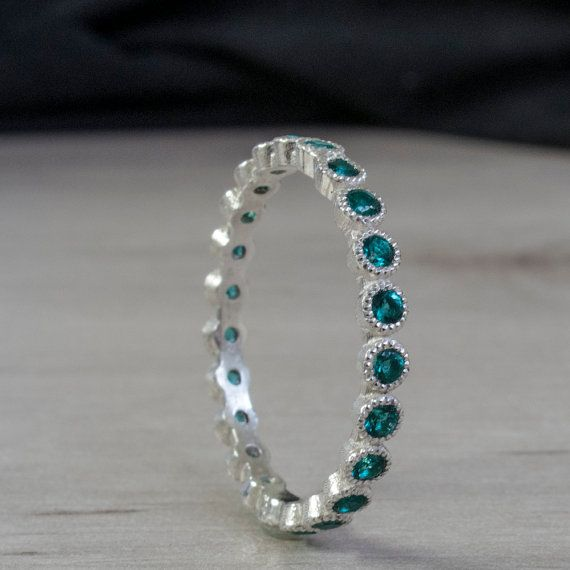 Strikingly beautiful Handmade Eternity ring made with Silver or White Gold Set with Emeralds more Blue then Green with a beautiful shimmering hue. Most