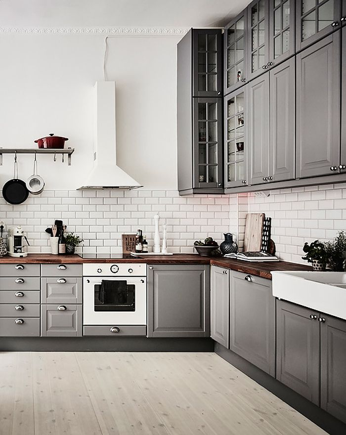 L-shaped kitchen layout grey white design concept