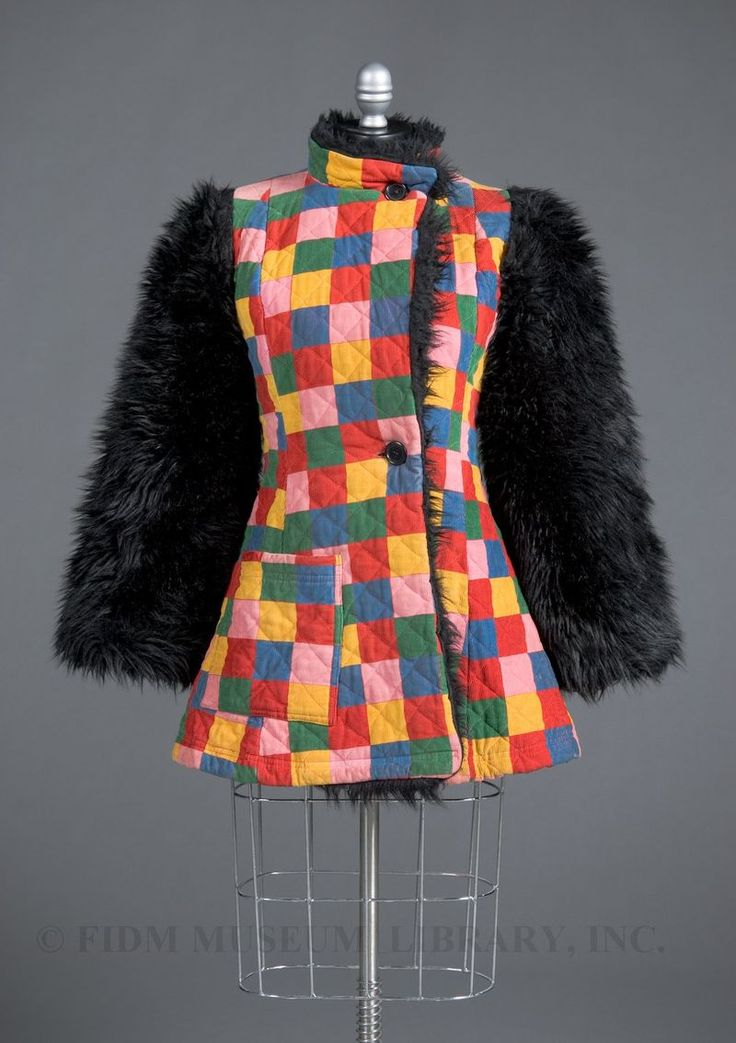 Your Very Own Vintage Betsey Johnson (Hello Alley Cat!) Could Walk the Runway at New York Fashion Week: An Alley Cat coat from 1971 with a patchwork corduroy body and faux fur sleeves. And gorilla sleeves are big for fall! What a coincidence!    Photo via FIDM Museum Blog
