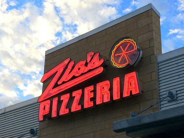 The neon signage of Zio's Pizzeria in Omaha.