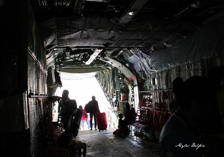 Inside, looking out of a military C130 cargo plane in the Philippines.