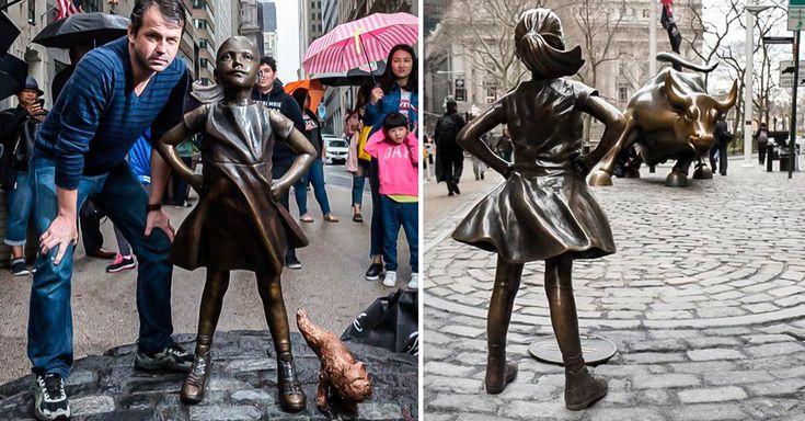 """Una de las esculturas icónicas de Wall Street, el """"Charging Bull"""", ha sido modificada al añadirle una niña sin miedo y un pug que la orina. ¿Qué significa?"""
