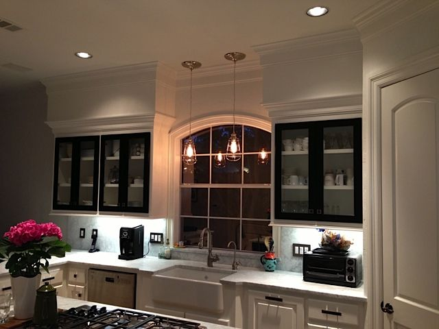 beautiful light fixtures (instant pendant lights!), white cabinets, apron  sink, marble countertop. love love love