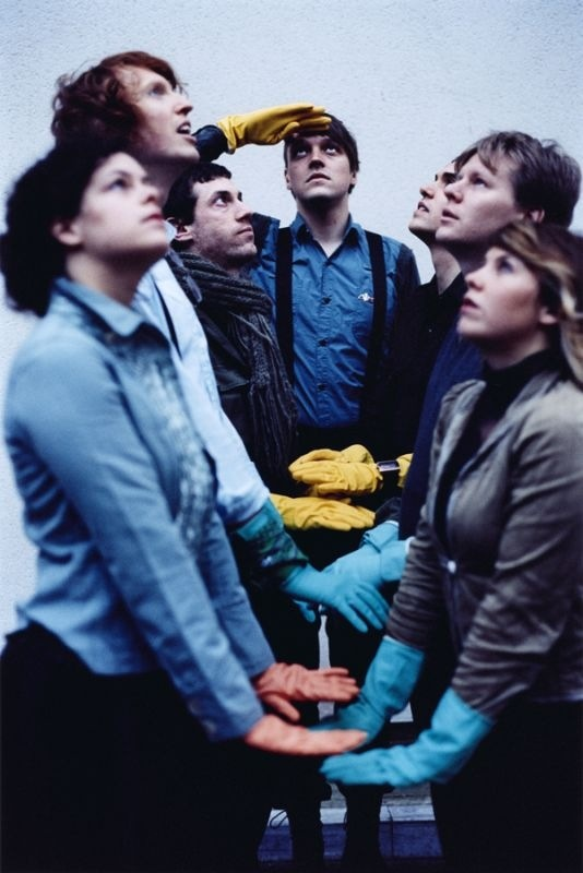 """Arcade Fire (this picture by Anton Corbijn). I saw them at Coachella in 2007, with the legendary drumsticks on the motorcycle helmet. Very epic.  Saw them again at Coachella seven years later. Debbie Harry came on to sing """"Heart of Glass"""" with them, and Régine Chassagne was visibly beside herself. Their set got cut at the very end of Wake Up, and they marched away with drums and a megaphone and everyone singing the """"oh ohhhs"""". Beautiful."""