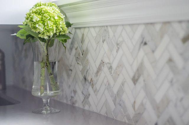Herringbone backsplash tile in Calacatta marble by Well-Nested Interiors