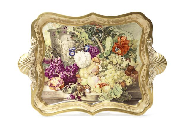 A large Spode tray, circa 1825-30 Possibly by John Cartlidge, painted with a full still life of fruit including grapes, apples and chestnuts amongst wild flora, with scattering butterflies throughout, displayed on a stone slab before a column modelled with Neoclassical figures, signed Jan Van Hysum., the shaped rim with a pale peach border highlighted with gilt medallions and two shell handles, 46.5cm wide, marked Spode