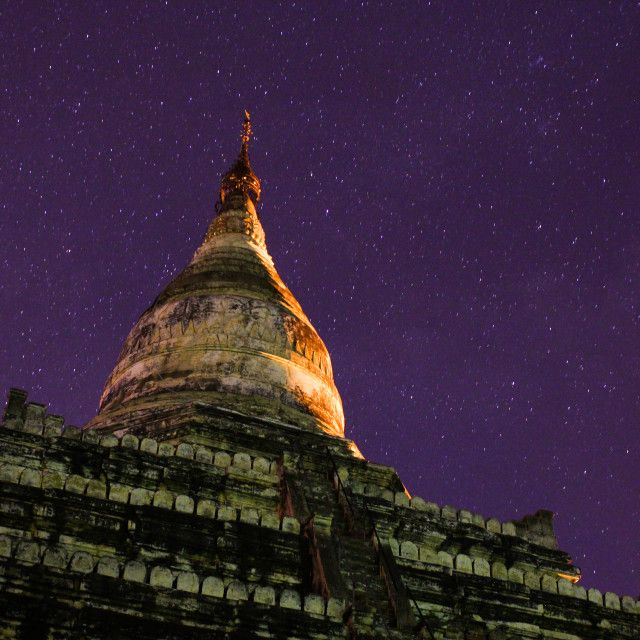 A photograph that I took at night using long exposure photography in Myanmar/Burma of a temple/pagoda with the stars shining bright behind this beautiful structure! Click the link if you are interested in licensing this photo! Temple and stars at Picfair.com