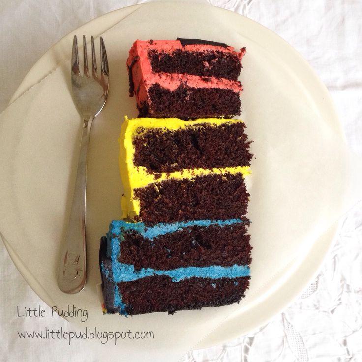 Superhero cake slice #superherocake #redyellowblue #littlepuddingcakes