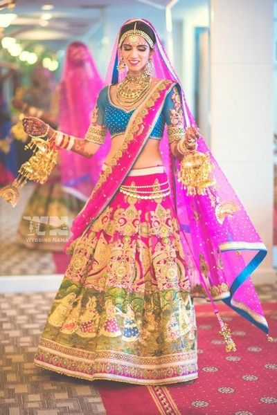Bridal Lehengas - Bright Blue Blouse, Pink and Green Lehenga with Gold Zari Work and Pink and Gold Dupatta | WedMeGood #wedmegood #pink #gold #bridal #lehenga