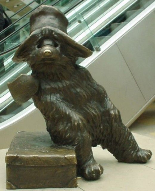 Paddington Bear - Location: Paddington Railway Station -- Paddington Bear is the famous children's literary character created by Michael Bond. Called Paddington Bear because he was found at Paddington Station. He is famous for his hat, duffle coat and love of marmalade sandwiches.