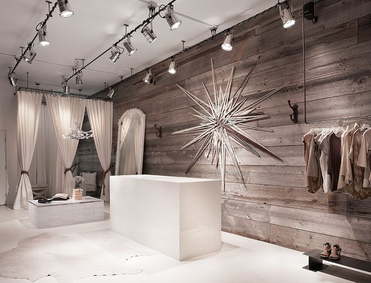 Ruti Boutique love the silver and white and clean feel- and all that track lighting to make everything bright and pop!