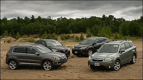 2013 Compact #Crossover Comparison Test | Auto123.com - We gathered the 2014 #Mazda #CX5, 2013 #Volkswagen #Tiguan, 2014 #Subaru #Forester and 2013 #Toyota #RAV4. With miles of open country roads, a bit of off-roading, and four drivers well placed to judge the practicality, drivability, and durability of these compact crossovers, we hit the road.