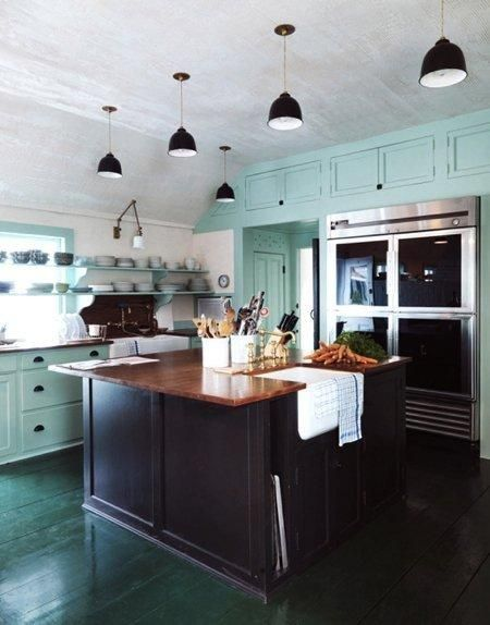 Great colour scheme. I love the black cabinets with the dark wood bench tops. The blue and green lift it and stop it from looking dark  dreary.