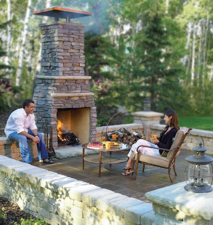 Fire pit with retaining wall backyard landscape ideas for Outdoor patio fireplace ideas