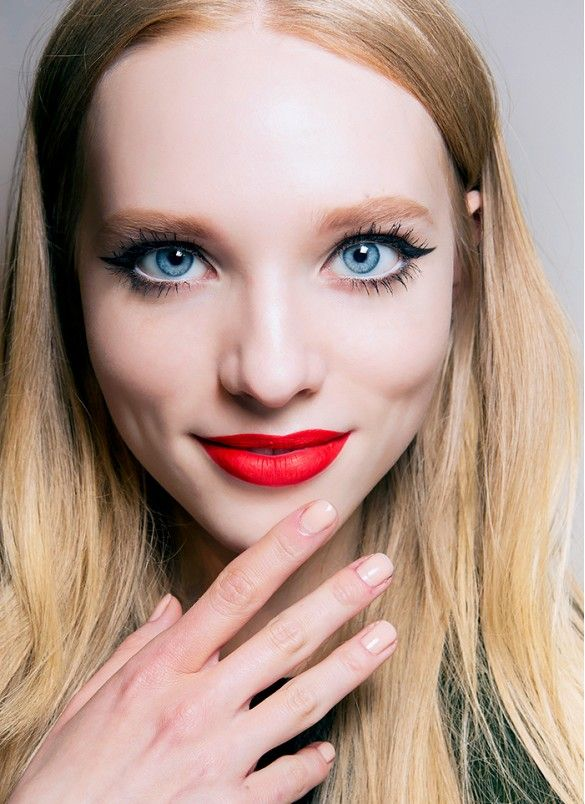 Perfectly-flicked liner + bright red lips