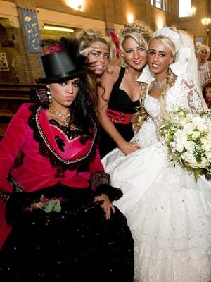 My Big Fat Gypsy Wedding ~ Lots of $$$$$ & lots of color ~ Gypsy Wedding Dresses ~ The top hat is a really nice touch...