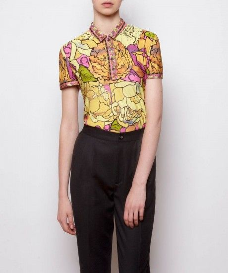 The classic four button shirt is enlivened this season with an all over vintage inspired floral print and 'border' twin tipping to the collar and cuffs. Crafted in a lightweight rayon fabric and cut with a slim fit; make a statement and layer under black