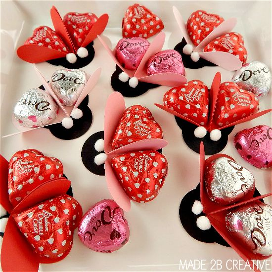 DIY ladybug Craft Idea. Made with cardstock, heart wrapped candy, and pom poms.
