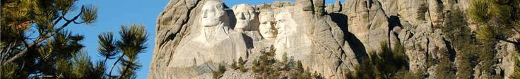 Use with A Mountain of History McGraw Hill Wonders 3rd grade Mount Rushmore, Washington, Jefferson, T. Roosevelt, Lincoln framed by ponderosa pine trees under a bright blue sky.