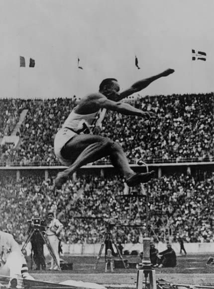 Jesse Owens was the most successful athlete in the 1936 Olympics. At a time when the Nazi authorities in Berlin were propagating Aryan supremacy, Jesse Owens' superb performance was looked upon as a fitting answer to Adolf Hitler. This image, put into context, speaks volumes of Owens' timely victories