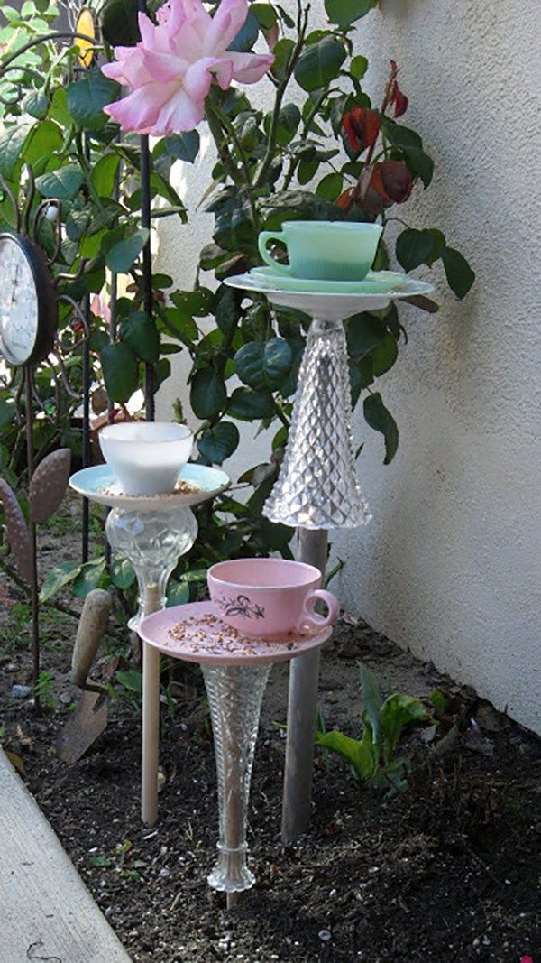 Tea Cup Stand Bird Feeders - click through to see more fabulous bird houses