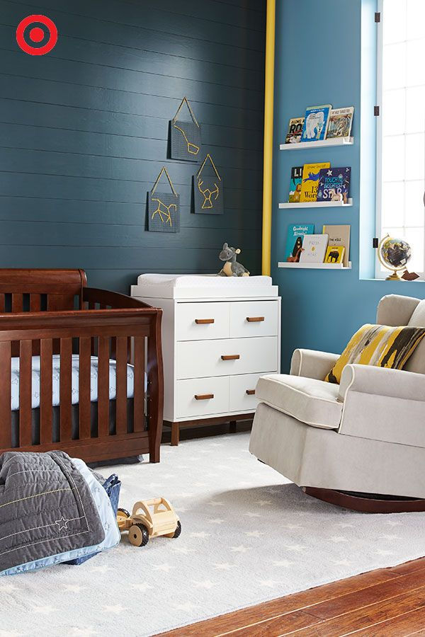 Soon arriving: Your baby boy. Now's the time to create his little launch pad, complete with multifunctional nursery pieces. The convertible crib transitions to a toddler bed and a full-sized bed, and the changer dresser features a removable changer tray. Both are perfect for years and years of use. Add an upholstered glider to gently rock him as he dreams of worlds beyond.