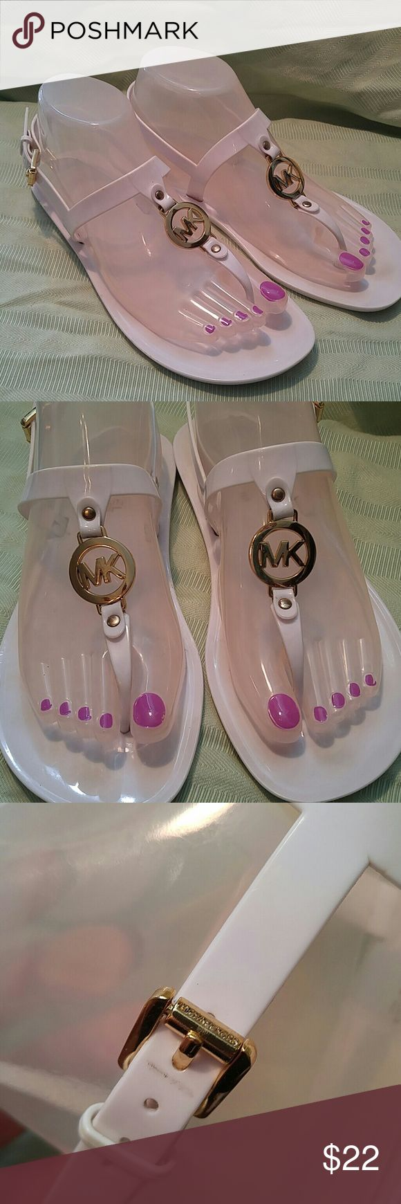 "Michael Kors White Plastic Sandals Gold Trim 8? Michael Kors White Plastic Sandals with Gold Trim. I am pretty sure they are an  8. Measures 9 3/4"" end to end on the bottom.  Preowned but still in pretty good shape. Michael Kors Shoes Sandals"