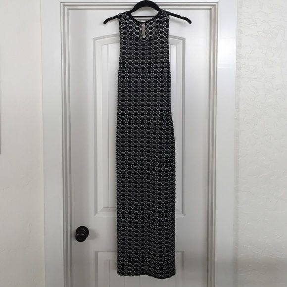 Cute long tight dress Grey, black and white tight dress that goes to about your mid calf. You can dress this sexy dress up or down.NWOT Dresses