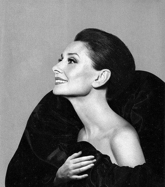 Audrey in Valentino is photographed by Avedon for Revlon ad, 1987