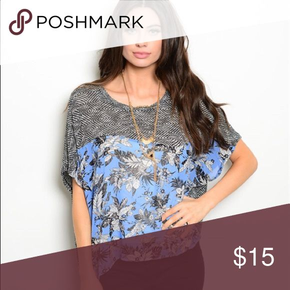 Soft blouse in two pattern design with batwing Just as pictured, two pattern design in blue, black and white. Soft floral chiffon material with even softer knit black/white check pattern. Very cute! Available in Small or Medium. Batwing sleeves. Tops Blouses