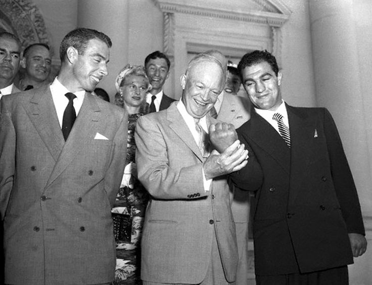 Italian American heroes with the President. Joe DiMaggio, President Dwight Eisenhower, Rocky Marciano in 1953