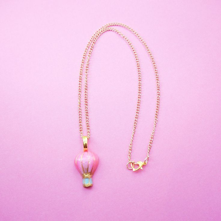 Adorable handcraft necklace.    *handmade with resin  *hand painted  *coated in resin  *18 inch gold chain  *heart clasp